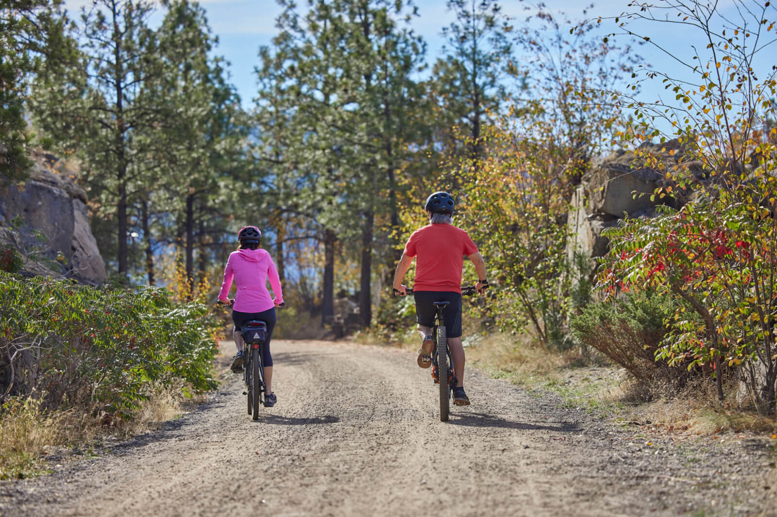 lady and man on bikes on trail